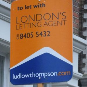 A shaped Ludlow Thompson estate agent board from Henderson Signs.